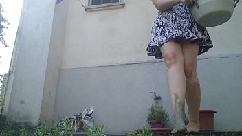 Lick my yellow boots completely dirty with green mud while I'm in the garden