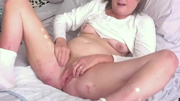 brunette milf fingers her hot cunt spreads pussy wide