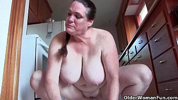 Naked grannies tube - Granny with big tits cleaning the kitchen naked