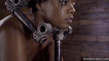 Ebony in device bondage is toyed
