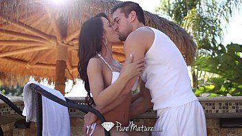 Image: Sexy Capri Cavanni loses her bikini with the poolboy - PureMature