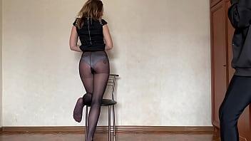 Pantyhose legs photos - Andrea in black skirt, black pantyhose and panties doing photoshoot