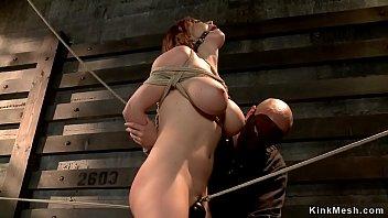 Brunette in hogtie gets pussy toyed