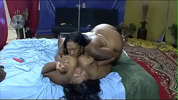 Oiled up chocolate BBW lesbians Sexy Phat and Haitian Beauty in hardcore dildo action
