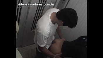 Horny man orders exhibitionist girlfriend to have sex with friend inside residential elevator
