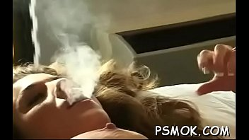 Women smoking and having sex Playing with her moist bawdy cleft