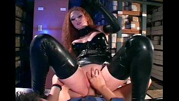 Sexy redhead getting fucked in shiny black latex