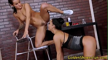 Tanned lesbian coach pussy licked