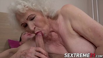Tantalizing MILF seduces young boy with blowjob and fuck