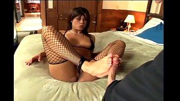 Kinky footjob in ripped up black fishnet stockings