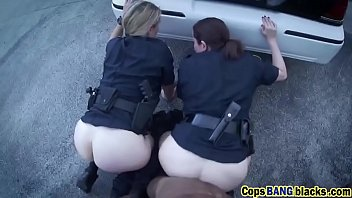 Horny cops bust criminal into fucking them in a public alley