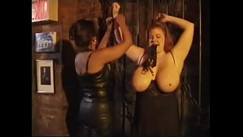 Ebony slut in black lingerie ties up redhead chubby chick and spanks her huge tits