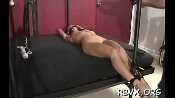 Ballgagged doxy gets aroused whilst playing with herself