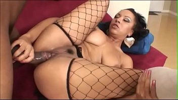 African whore Misti Love wearing only fishnets stockings gets black cock