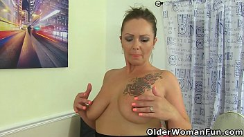 British mature Sam plays with a magic wand massager