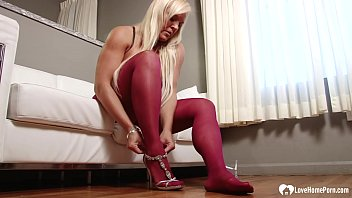 MILF in pantyhose displays her smoking legs