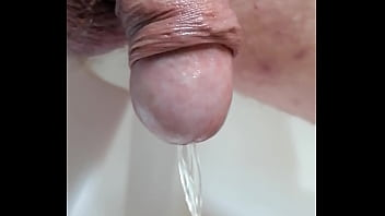 Penis closeups Penis pee , piss in the tub.