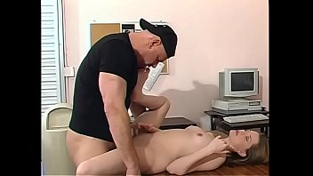 Horny older stud licks blondie's foot while he pounds her on his desk