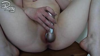 Amateur girl masturbates with vibrator on a chair