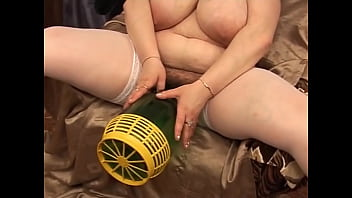 Drunk mom trying to push in a huge bottle in her cunt - FreeMatureCameras.com