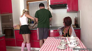 Future m. and teen toying at the kitchen