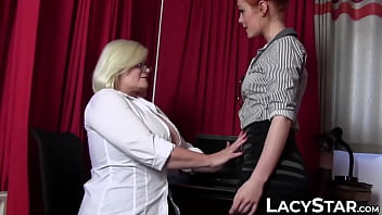 Busty GILF fucks a gorgeous redhead at the office