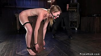 Gagged brunette spanked and whipped