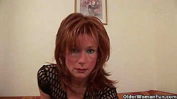 Redhead granny porn - Sultry senior lady is toying her meaty pussy