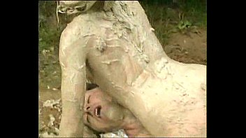 Muddy Woman Attacks And Humps Guy In The Mud