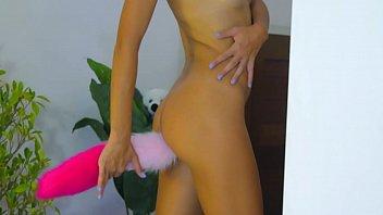 Nude dance wearing fox tail and heels