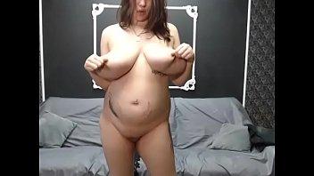 Huge pregnant milf lived teasing her big tits