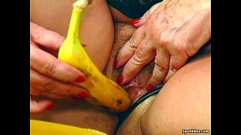 Granny masturbates with a banana preview image