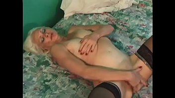 Image: Slutty MILF Kathy Jones gets large cock to suck while fingering her pussy