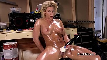 Oiled Blonde Gets Double Penetration Machine