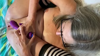 Mature stepmom toys hot cunt fantasizing about stepson with her purple dildo