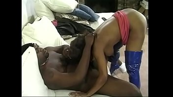Black chick Camille in blue latex boots gets fucked