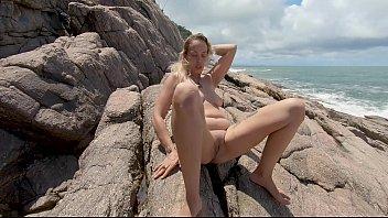 Cumming on the edge of the sea