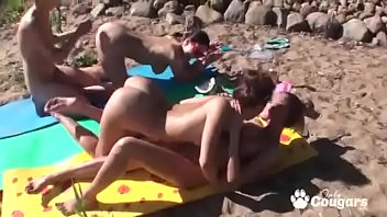 Naughty Girlfriends Have A Lesbian Orgy At A Nude Beach
