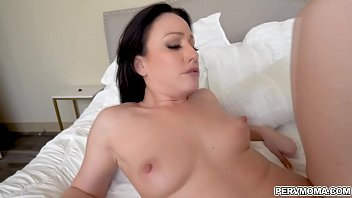 The naughty stepmom takes her top off and lets her stepson feast on her perfect titties!