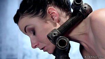 Helpless brunette in metal devices