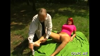Savory redhead lady Laura with big natural tits chokes on a big one