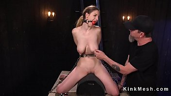 Bent over wooden beam slave gagged