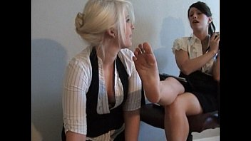 lesbian reading a book while worshiping her feet 3