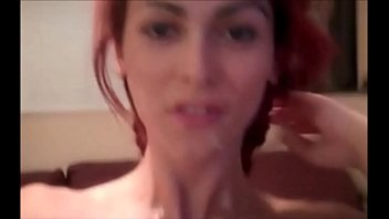 Redhead Shemale Shoots her Load on her Own Face