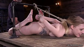 Hogtied blonde slave gets pussy fingered
