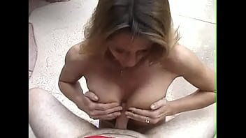 Woman with huge jugs gives great head to her man