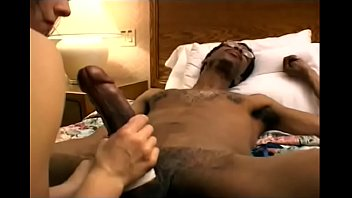 Awesome brunette babe likes to walk on black dude's dong with her high-heel shoes before playing with giant tool