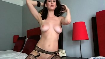 Young beauty in stockings fingers her tight pink pussy on webcam