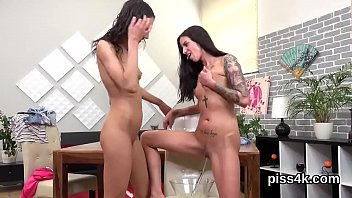Elegant lezzie girls get sprayed with piss and squirt wet pussies