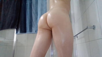 Young oiled ass in catsuit...